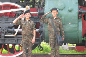 Young cadets are dwarfed by a locomotive at Uzbekistan's National Railway Museum in Tashkent. Photo / Jill Worrall