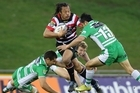 Tana Umaga fends off Shannon Paku. Photo / Getty Images