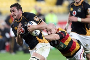 Daniel Ramsay breaks the tackle of Waikato's Brendon Leonard during Wellington's win last night. Photo / Getty Images