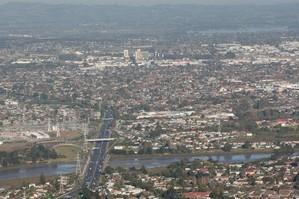 Southern Motorway, Otahuhu and Otara with Manukau in the Background. Photo / NZ Herald