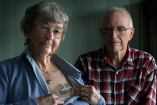 Jan Follas, pictured with husband Eric, has 'do not resuscitate' tattooed on her chest. Photo / APN