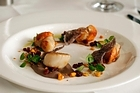 Pan-seared Nelson scallops on Spanish black bean and coconut puree at Dine by Peter Gordon. Photo / Sarah Ivey