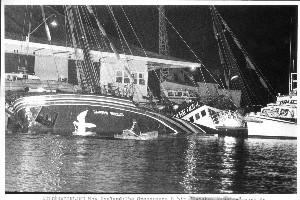The Rainbow Warrior sinks into Auckland Harbour after the explosions. Photo / Ben Motu