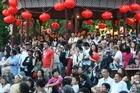 Crowds gather under lanterns at the Chinese Lantern Festival in Auckland's Albert Park. Photo / Paul Estcourt