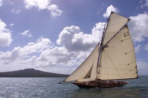 Cutter 'Waitangi' passes by Rangitoto Island during racing in the Logan Classic. Photo / Kenny Rodger.
