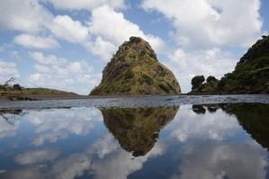 Lion Rock at Piha stands near the edge of a giant undersea volcano. Photo / Paul Estcourt