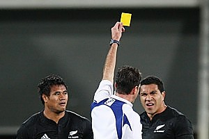 All Black centre Isaia Toeava receives the yellow card from referee Craig Joubert,  despite the protest of Mils Muliaina. Photo / Mark Mitchell