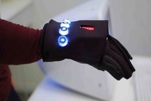 Each glove contains custom-made electronics and sensors that allows communication between them via a wireless protocol. Photo / Supplied