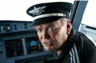 Graham Henry stars as a pilot in the new in-flight video. Photo / Air New Zealand