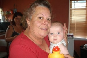 Penelope Phillips, seen here with her grandson Deklin McKenzie, was killed when a car driven by Frances Carol Stubbs fled a police check point and crashed into her car. Photo / Supplied
