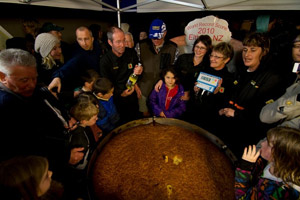 Eltham residents with their world record-breaking scone. Photo / Supplied
