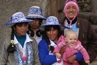 In Cusco where some local girls, on a school trip in typical costume, were fascinated by Emelia. Photo / David King