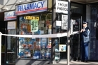 Police at the scene at Gillards Pharmacy on New North Rd, Mt Albert. Photo / Brett Phibbs