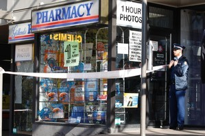 Police at the scene at Gillards Pharmacy on New North Rd, Mt Albert. Photo / Brett Phibbs