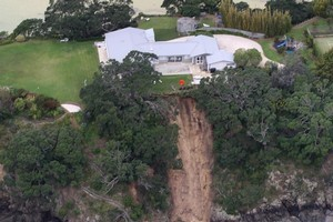 A house in Owhanake Bay is perched precariously close to the cliff edge. Photo / Natalie Slade