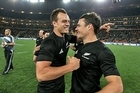 Israel Dagg and Dan Carter celebrate the Al Blacks' 29-22 victory over the Springboks. Photo / Getty Images