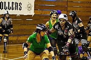 The Dead Wreckoning face off against Mascara Massacre in the Pirate City Rollers league. Photo/ Matalin Hatchard.