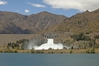 The Benmore Dam in the Waitaki Valley as Meridian Energy spilled water from the hydro lakes. Photo / Simon Baker