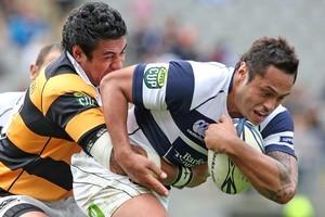George Pisi of Taranaki tackles Ben Atiga of Auckland. Photo / Getty Images