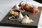 Cured salmon with licorice puree, goat's cheese and mascarpone sorbet. Photo / Doug Sherring