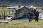 Police at the scene of the plane crash at Fox Glacier airfield. Photo / Sarah Ivey