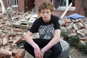 Xavier Trousselot-Rhodes returns yesterday to the rubble of his father's Hororata home. Photo / Mark Mitchell