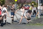 Students help out in cleaning up Rydall Street, Hoon Hay. Photo / Mark Mitchell