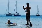 Jeremy Stephenson paddles his son Andrew, 1, on his stand-up paddle board at Palm Beach, Waiheke. Photo / Supplied