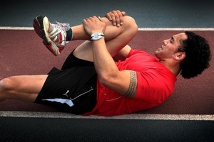 Ruben Wiki stretches before a marathon training session this week. Photo / Doug Sherring