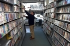Store managers may spend 8 to 10 hours a week chasing DVDs and games that have not been returned. Photo / Brendon O'Hagan