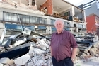 Westende Gemtime Jewellers owner Roger Kelso among the rubble covering his business on the corner of Worchester and Manchester Streets in in central Christchurch. Photo / Mark Mitchell