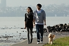 Vaughan Smith and Sharde Thanatharakij walk their dog Lulu Belle along the Te Atatu Peninsula Walkway. Photo / Brett Phibbs