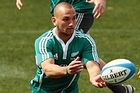 First five-eighths Aaron Cruden passes the ball as the All Blacks train in Sydney yesterday. Photo / Getty Images