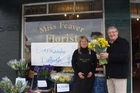 Jim Anderton buys 10 bunches of daffodils from Miss Feaver Florist in an