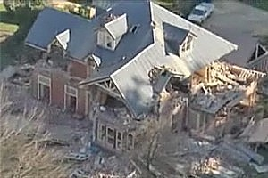 A still from footage taken from a helicopter shows the Deans family's historic Homebush homestead in ruins.