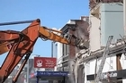 The bulldozers move in to demolish unsafe buildings in the centre of Christchurch following a major earthquake.