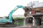 A damaged Riccarton Road building was reduced to rubble today, following Saturday's quake.