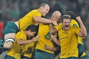 Australia celebrate after beating the Springboks with a last minute penalty. Photo / Getty Images