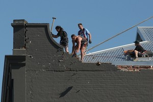Workers making emergency repairs to a building after the Christchurch earthquake. Photo / Greg Bowker