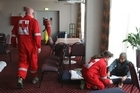 Red Cross workers at the Addington Race Course Emergency Welfare Centre. Photo / Greg Bowker