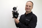 Fisher & Paykel chief executive Stuart Broadhurst with one of the new fridge compressors. Photo / NZPA