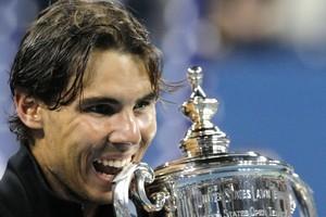 Rafael Nadal of Spain bites his trophy after beating Novak Djokovic. Photo / AP