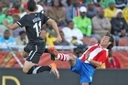 Leo Bertos in action against Paraguay at the World Cup. Photo / Brett Phibbs