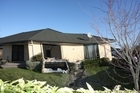 A damaged house on Courtenay Drive following the 7.1 magnitude earthquake in Christchurch. Photo / Herald on Sunday