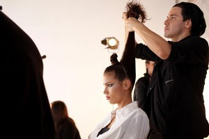 Danny Pato carries out hair trials for test shots in advance of Kathryn Wilson's Fashion Week show. Photo / Supplied
