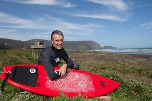 Craig Levers takes advantage of the surf near his home at Piha. Photo / Supplied
