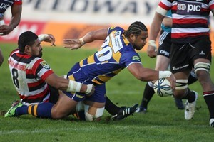 Taniela Moa touches down for one of Counties' three tries as Fritz Lee tries to stop him. Photo / Sam Ackland