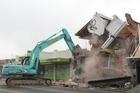 A brick building at 90 Riccarton Road is demolished. Photo / Greg Bowker