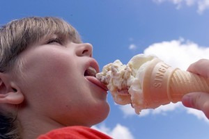 Sam Duck, 9, savours a hokey-pokey icecream. Photo / Paul Estcourt