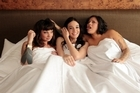 Hollie Smith, Shannon Ryan and Anika Moa in bed together at the Langham Hotel, Auckland. Photo / HoS.